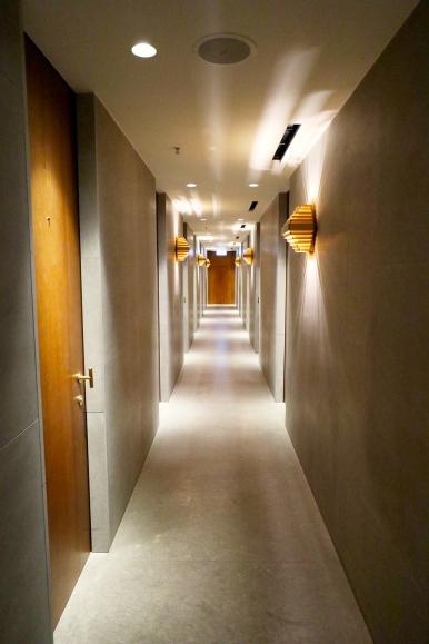 Corridor to showers. (Photo: MainlyMiles)